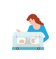 mom or nurse look at baby in incubator vector image