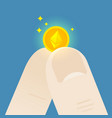 fingers hold a small ethereum coin vector image vector image