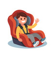 Child sits in a red car seat