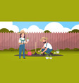 couple farmers planting young seedlings plants vector image