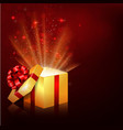 golden gift boxes with red bow and ribbon vector image vector image