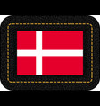 flag of denmark icon on black leather backdrop vector image vector image