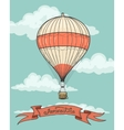 Retro hot air balloon with ribbon vector image