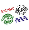 grunge textured stay tuned seal stamps vector image