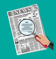 hand holding magnifying glass over newspaper vector image