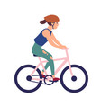 happy young woman in helmet riding bike smiling vector image vector image
