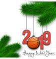 basketball ball and 2019 on christmas tree branch vector image