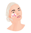 a girl covering a cream onto her face vector image vector image