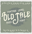 vintage label typeface called old tale vector image