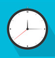 analog watch hanging on blue wall vector image