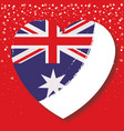 australian flag on heart in red background with vector image vector image