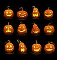 halloween pumpkins faces glowing in darkness vector image
