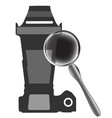 gray camera and magnifier on white vector image