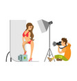 model in swimsuit and photographer at photo studio vector image