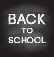 back to school handwritten with white chalk on a vector image