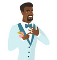 cheerful groom showing golden ring on his finger vector image vector image