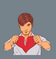 handsome man holding broken heart tearing red vector image