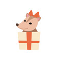 cute opossum with red bow on its head holding gift vector image vector image