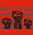 three clenched raised fists vector image