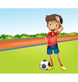 Boy playing football vector image vector image