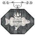 signboard for seafood with fish and sailboat vector image vector image