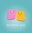 shopping bags colorful pink and yellow on blue vector image vector image