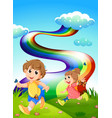 Kids walking at the hill with a rainbow in the sky vector image vector image