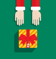 Santa Claus hand give gift Merry Christmas vector image