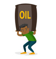 young african-american man carrying oil barrel