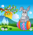 meadow with bunny on easter egg vector image vector image