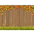 old wooden fence autumn tree and grass vector image vector image