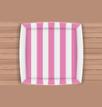 pink paper box on wooden table vector image vector image