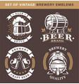 set of vintage brewery emblems on dark background vector image