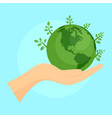 green planet in hand background flat style vector image