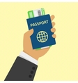 Hand holding passport with tickets vector image