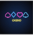 neon casino poker card suit sign brick wall vector image vector image