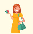 beautiful woman holding a credit card in her hand vector image vector image