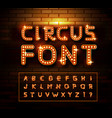 Circus marquee fonts on brick wall background