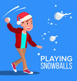 child boy in santa hat playing snowballs vector image