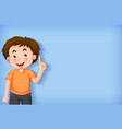 plain background with boy pointing his finger