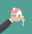 hand holding home in palm and key on finger vector image vector image
