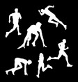 white silhouettes of athletes that run on a black vector image
