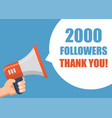 2000 followers thank you - hand holding megaphone vector image