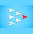 red paper airplane as a leader among white vector image vector image