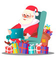 santa claus on the chair with laptop vector image
