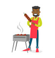 young african-american man cooking shashlik vector image vector image