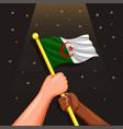 algeria flag on hand symbol for celebration vector image vector image