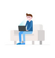 Smiling man sitting on sofa with laptop