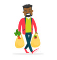 young man holding shopping bags with groceries vector image vector image