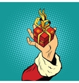 Hand of Santa Claus with gift vector image vector image